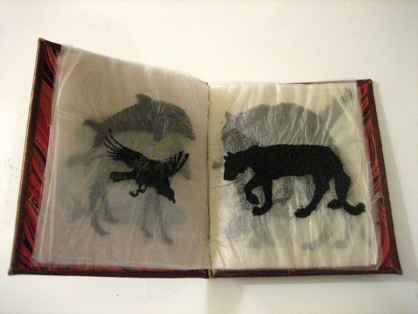 Fleshbook: india ink on goldbeaters skin; hand bound in leather and end papers resembling muscle